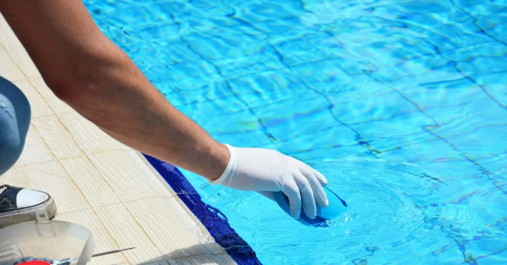 Pool Technician at sublime pools and spa performing a chlorine wash for a client