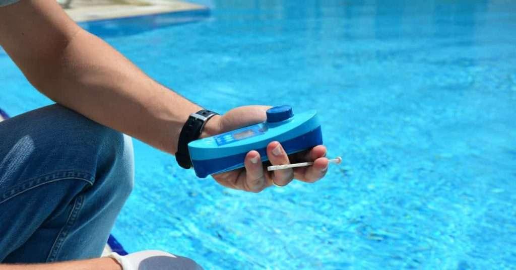 Pool man inspecting pool to ensure it is clean.