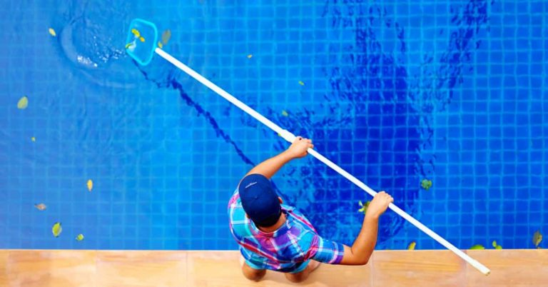 Pool technician providing pool cleaning service at Sublime Pools & Spa