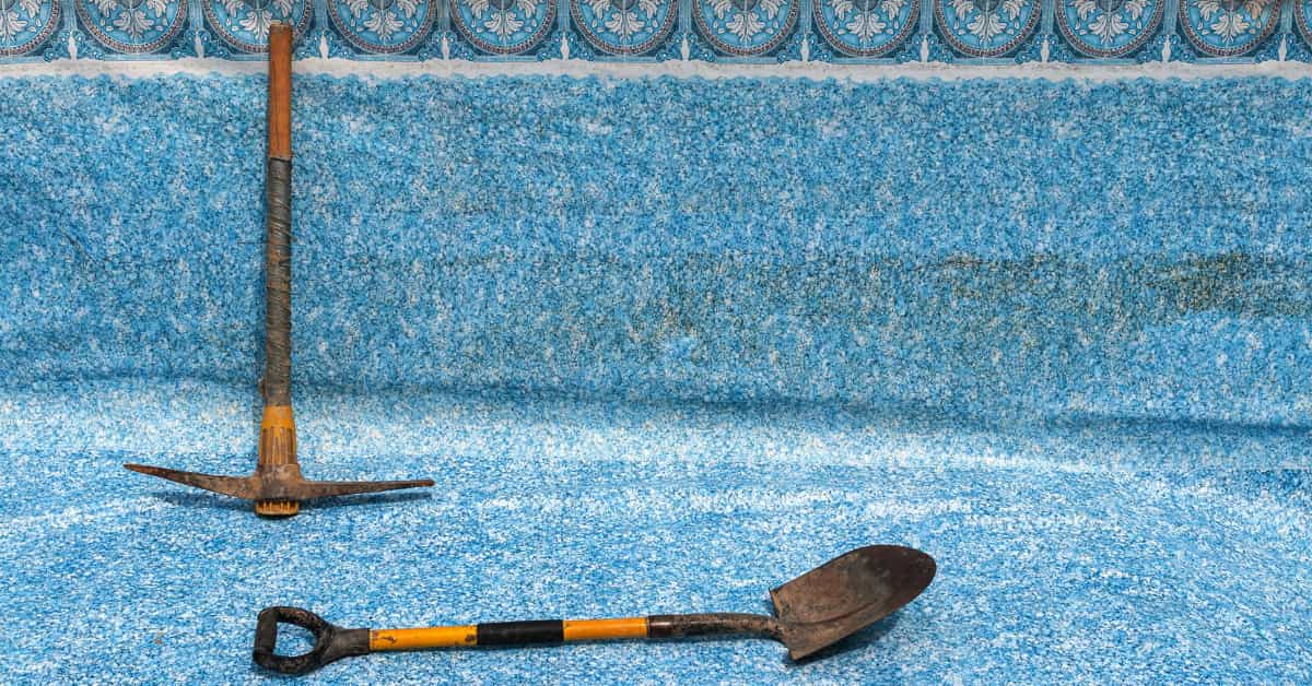 Pool repair equipment lying on a drained floor