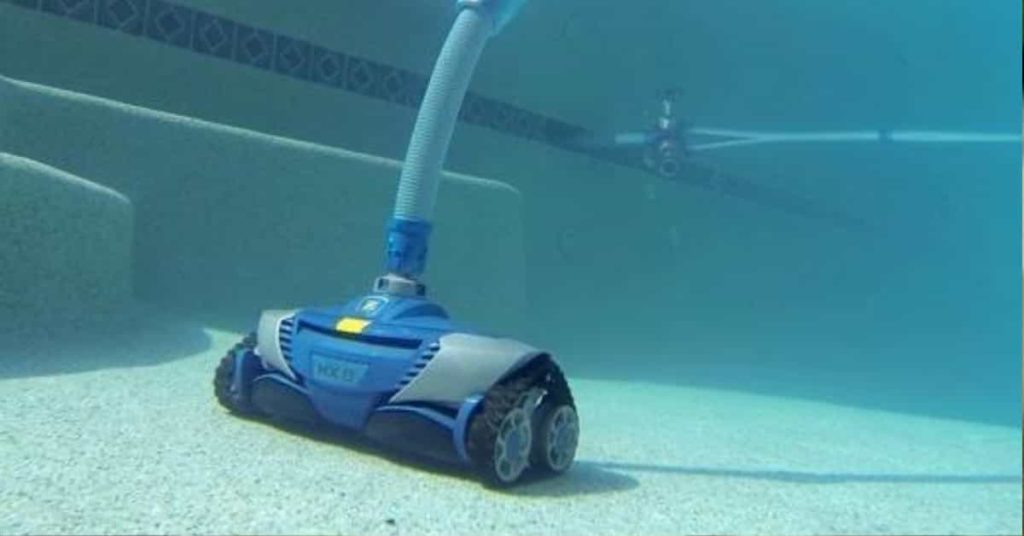 automatic pool vacuum cleaning a pool floor