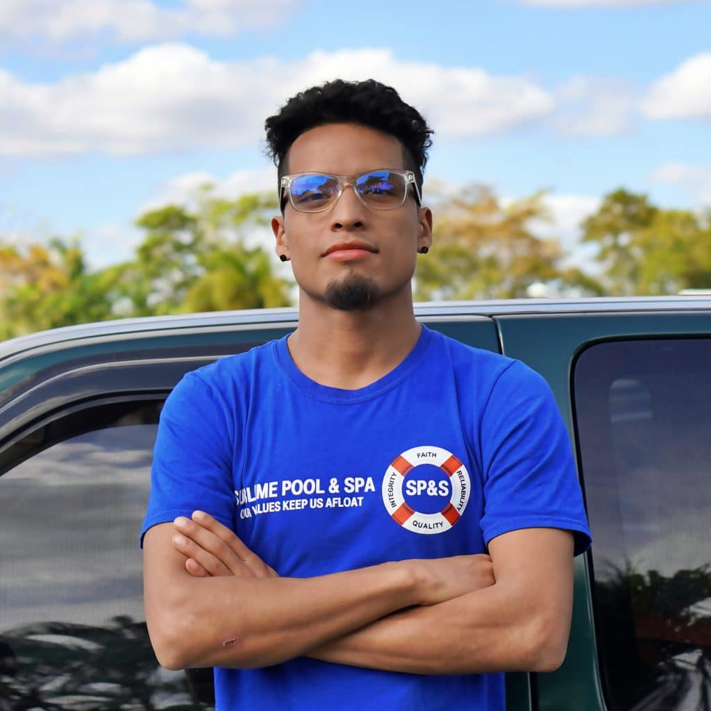 Photo of Marketing Director, Abner Molina wearing a blue Sublime Pools & Spa company shirt