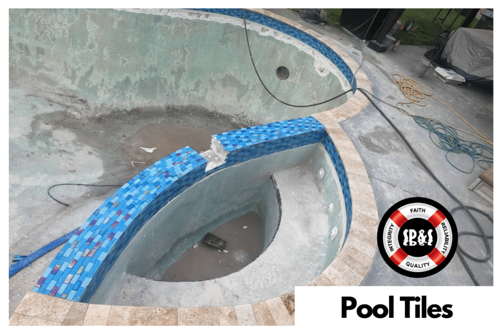 A swimming pool being replastered with new waterline pool tiles being added. The tiles being added are Lagoon 1x2 by NPT.