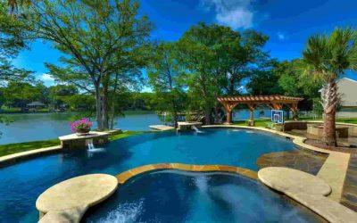 A dream backyard pool with a lake scenery